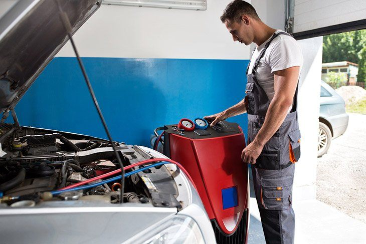 Mechanic-checks-the-air-conditioner-at-service-station