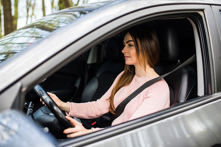 Young-woman-driving-her-car-safe-drive