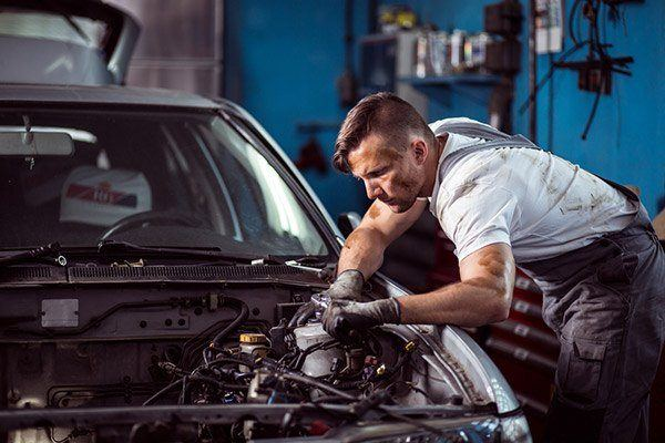 the man repair the car