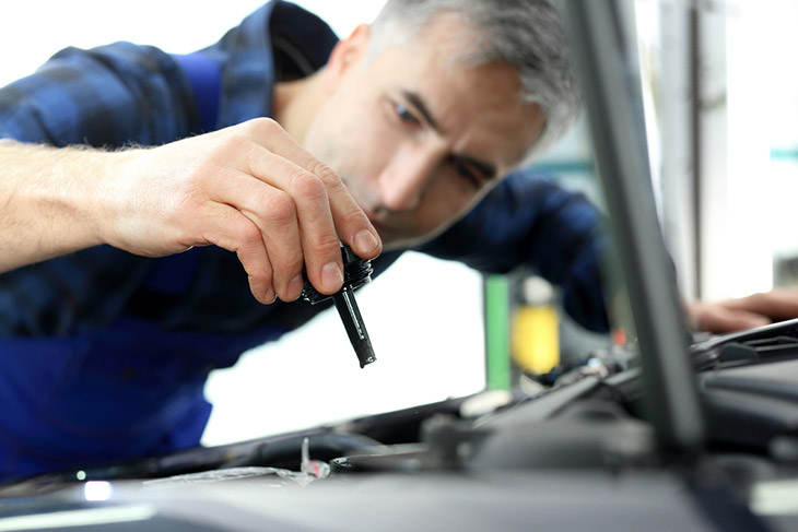 Steering-fluid-change.Car-mechanic-exchanges-steering-system-fluid