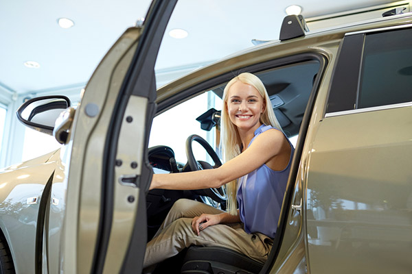 happy-woman-sitting-in-or-driving-car