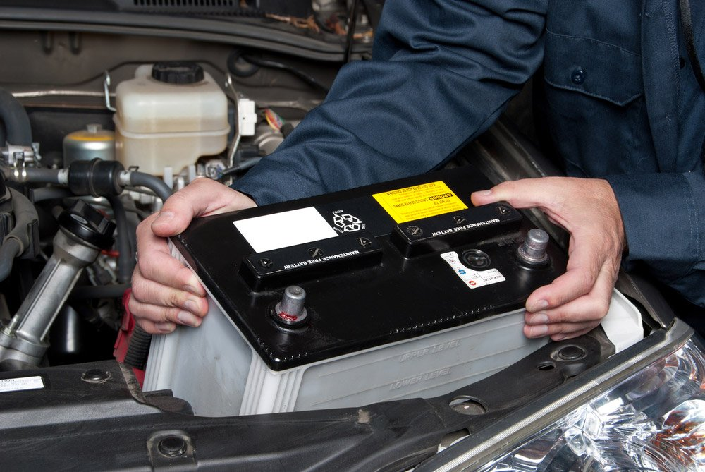 A-car-mechanic-replaces-a-battery